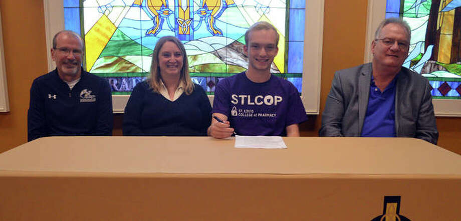 Father McGivney senior Zach Brasel, second from right, will compete in cross country and track and field at St. Louis College of Pharmacy. He is joined by his parents and FMCHS coach Jim Helton. Photo: Scott Marion/The Intelligencer
