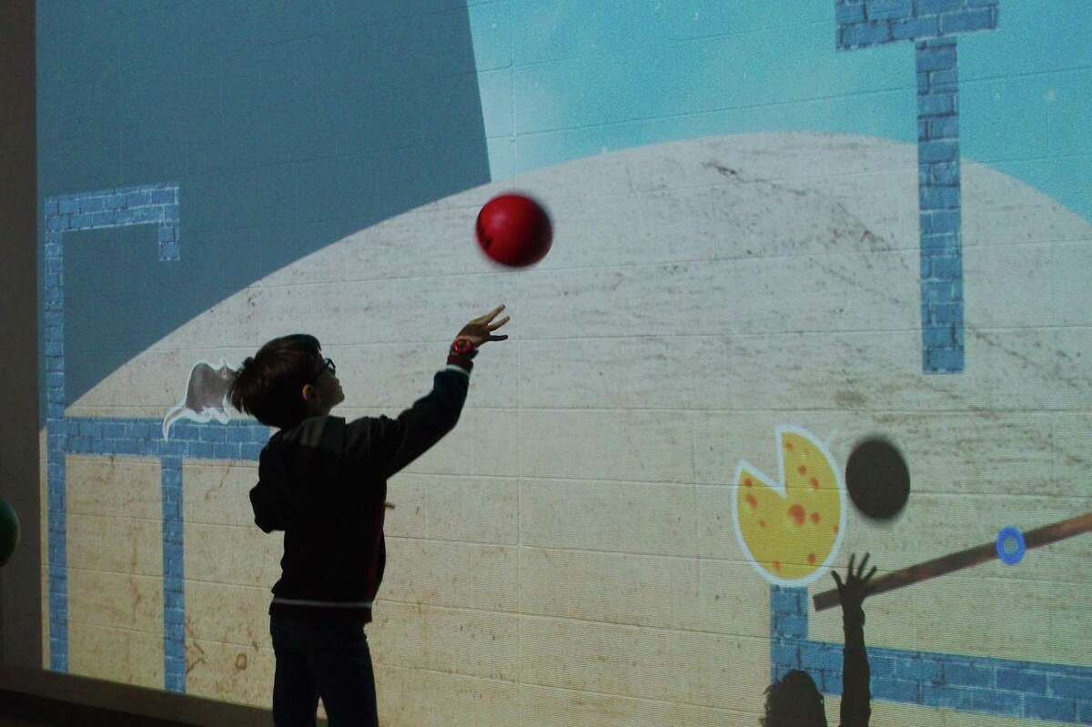 Hassan Zamzam tosses a ball to select the answer to a puzzle.