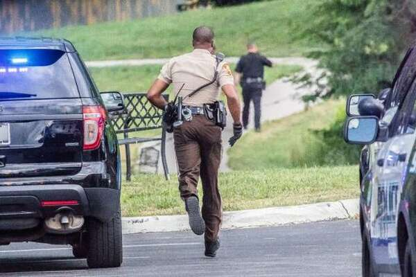 A St. Louis County Sheriff's Office deputy sprints to the after an armed carjacking in Alton led police on a chase that toured North St. Louis County, ending a few hundred feet off of Old Jamestown Road in June 2018.