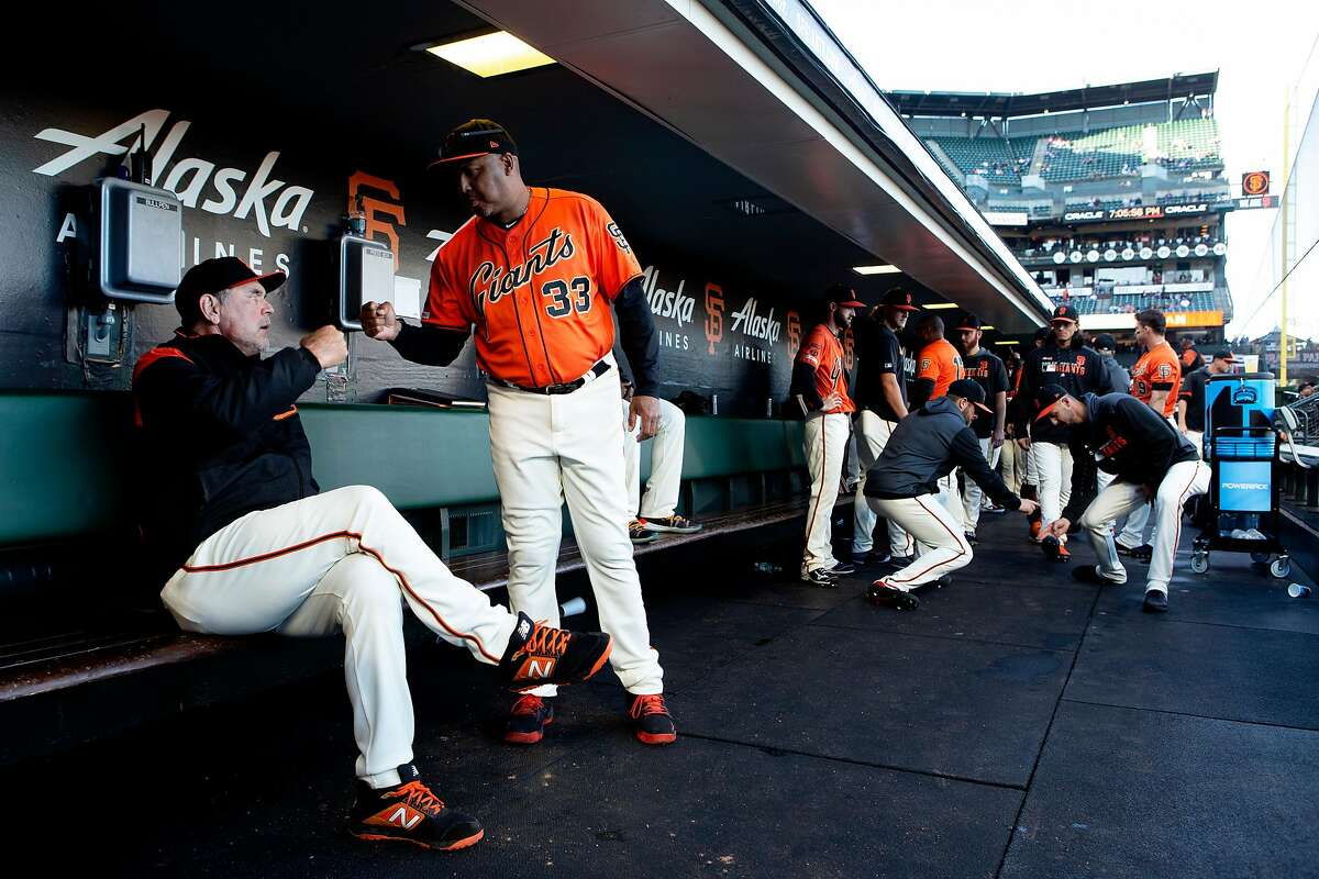 From left: San Francisco Giants manager Bruce Bochy (15) fist bumps Giants hitting coach Alonzo Powell (33) before an MLB game against the Los Angeles Dodgers on Friday, June 7, 2019, in San Francisco, Calif. The Giants won 2-1 against the Dodgers tonight for Bochy�s 1,001 win.