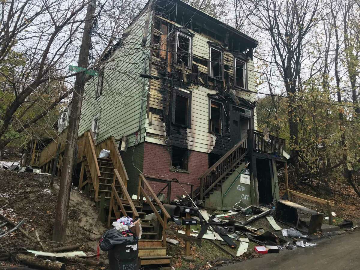 A two-alarm fire destroyed most of 1 Van Every Ave., Troy, N.Y. Tuesday Nov. 19, 2019. The building in the South Troy neighborhood is located on a slope that made firefighting difficult.