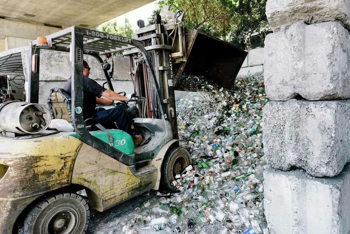 Glass bottles are piled at Our Planet Recycling in San Francisco, Calif. (Michael Short / Special to The Chronicle)