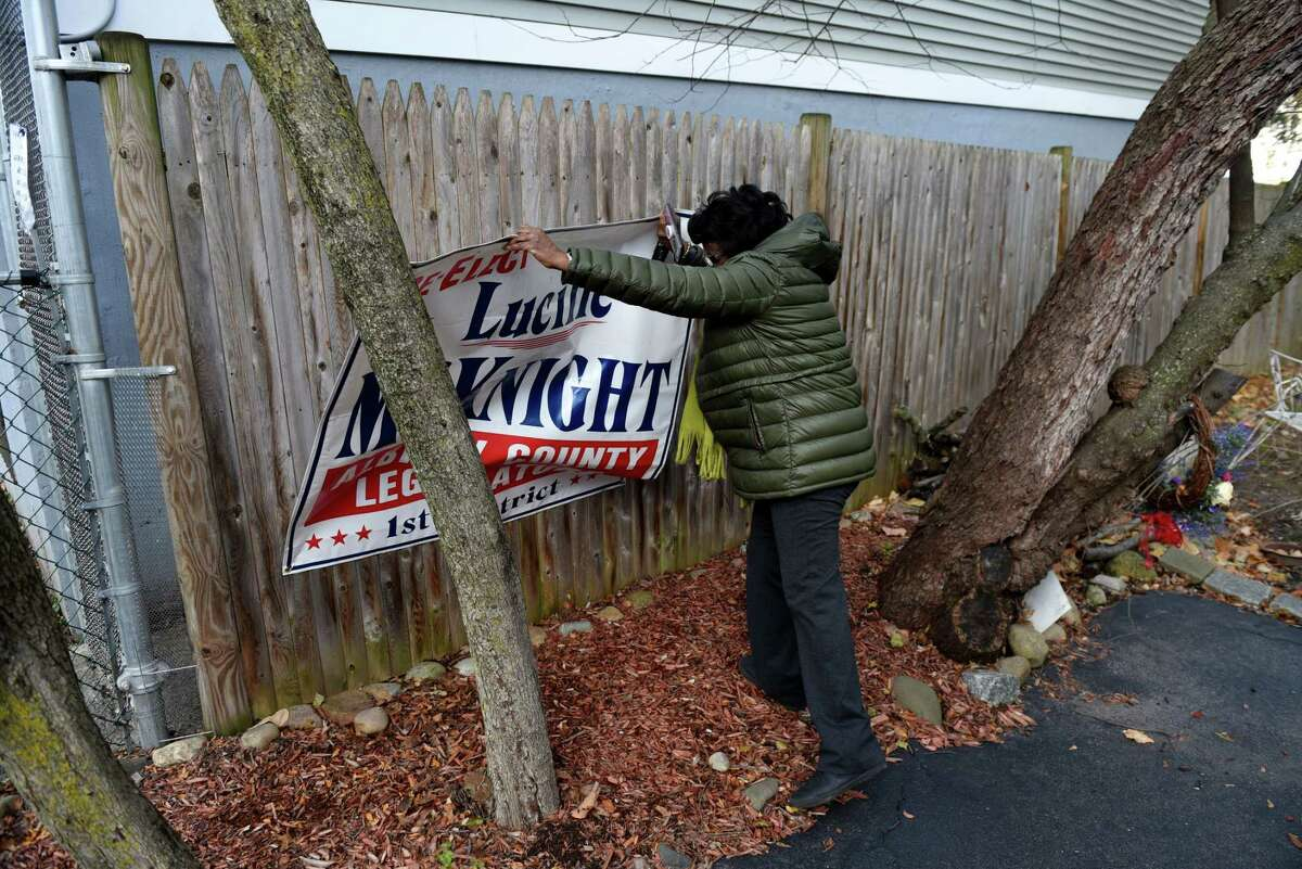 longtime Albany County Legislator Lucille McKnight takes down a campaign sign on her Third Avenue home on Friday, Nov. 15, 2019, in Albany, N.Y. McKnight will leave her seat after 27 years. She lost a four-way Democratic Primary for her 2nd legislative district seat in June. Former Albany Common Council President Carolyn McLaughlin was recently elected to the seat . (Will Waldron/Times Union)