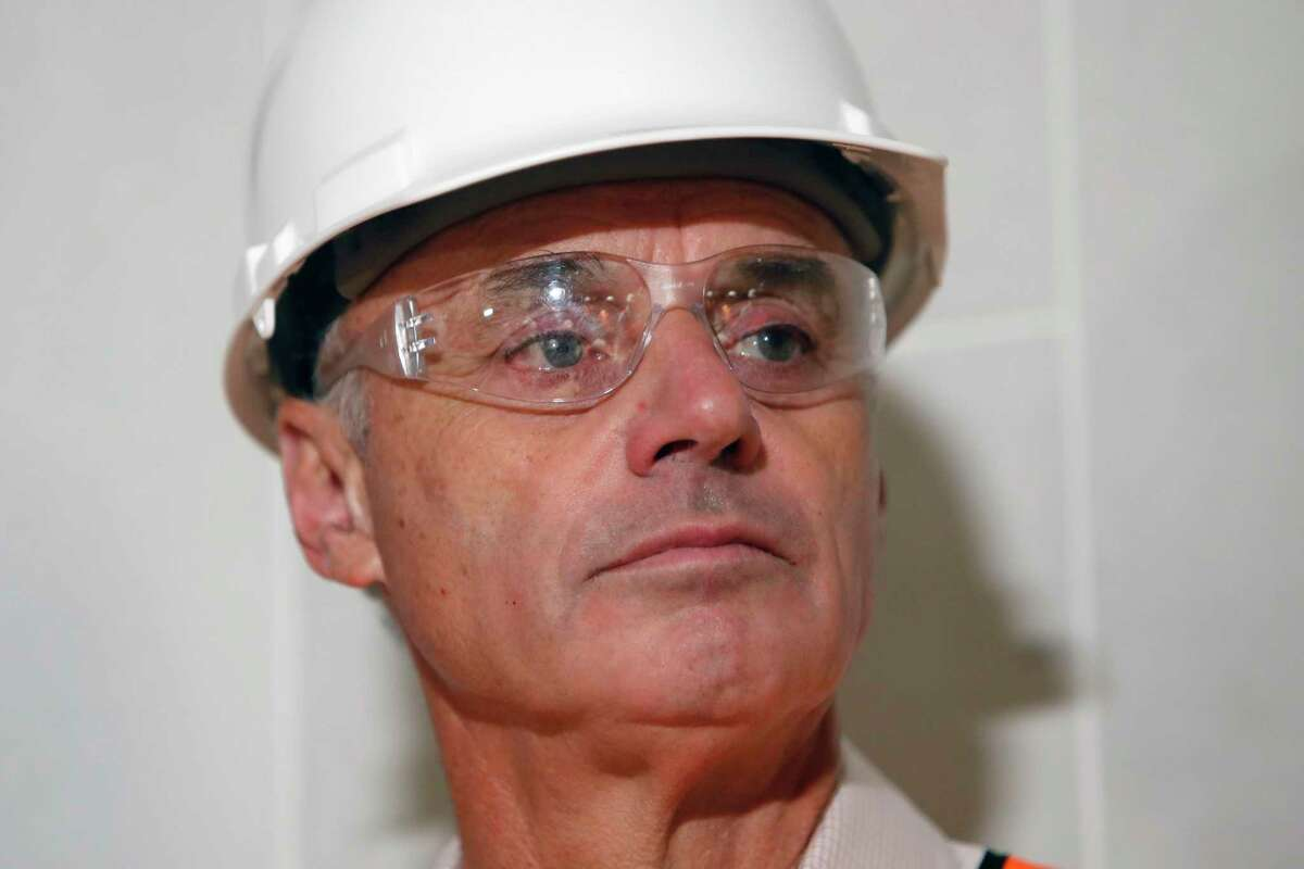 Baseball Commissioner Rob Manfred listens to a question during a tour of the under construction new Texas Rangers stadium in Arlington, Texas, Tuesday, Nov. 19, 2019. Manfred hopes the investigation into sign stealing by the Houston Astros will be completed by next season and says he has broad authority to impose discipline beyond fines, the loss of amateur draft picks and taking away international signing bonus pool allocation.