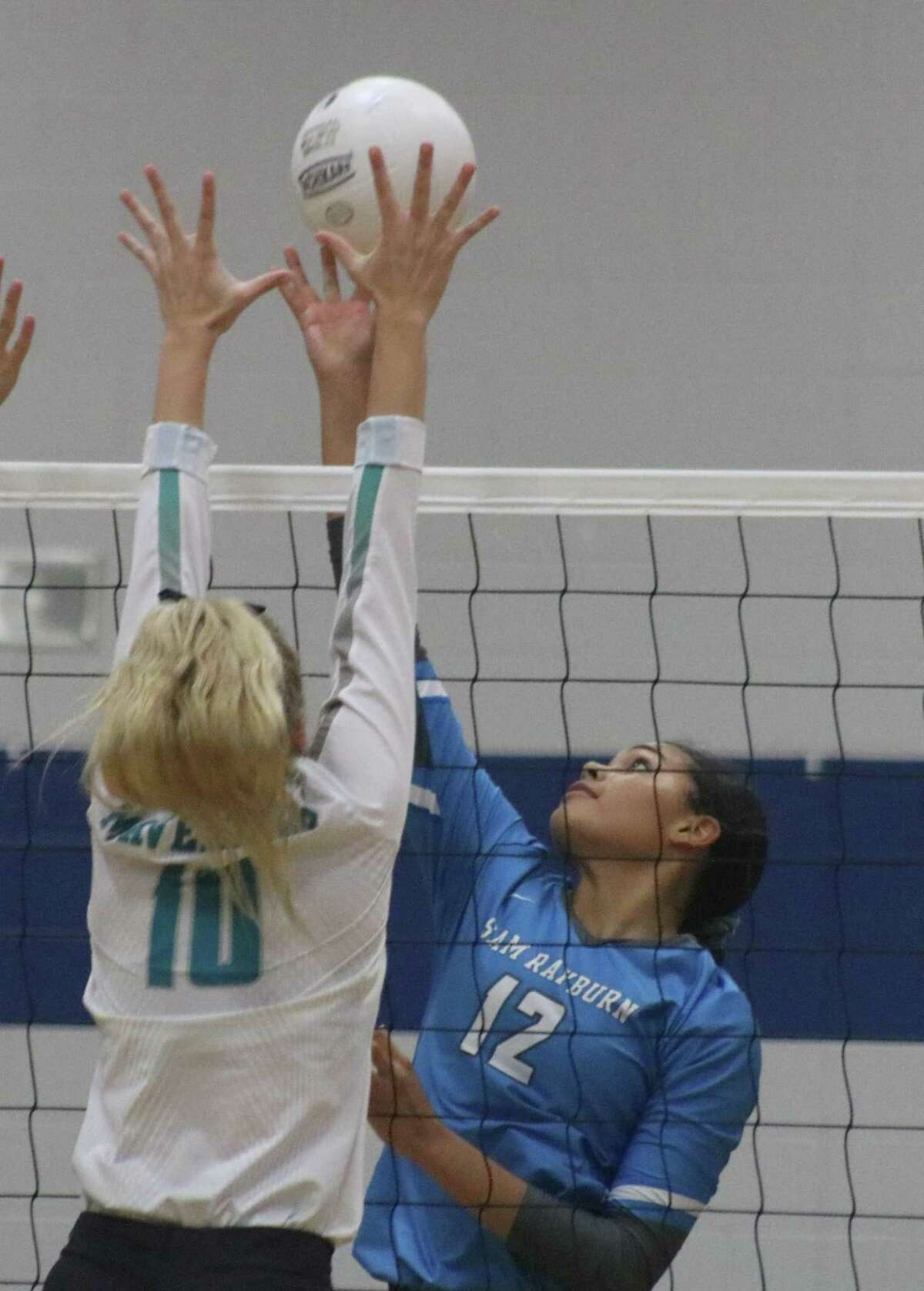 Sam Rayburn's Torrie Woods (12) attacks the defense of Memorial's Brandi Hemminger in one of two district encounters between the rivals. Hemminger captured First Team All-District accolades and Woods was named to honorable mention.