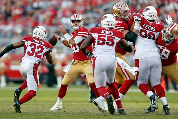 San Francisco 49ers' Jimmy Garoppolo looks to pass in 4th quarter of Niners' 36-26 win over Arizona Cardinals in NFL game at Levi's Stadium in Santa Clara, Calif., on Sunday, November 17, 2019.