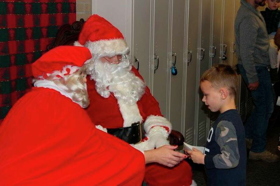 Santa and Mrs. Claus will visit children at the Holly Berry Arts and Crafts show. (File Photo)