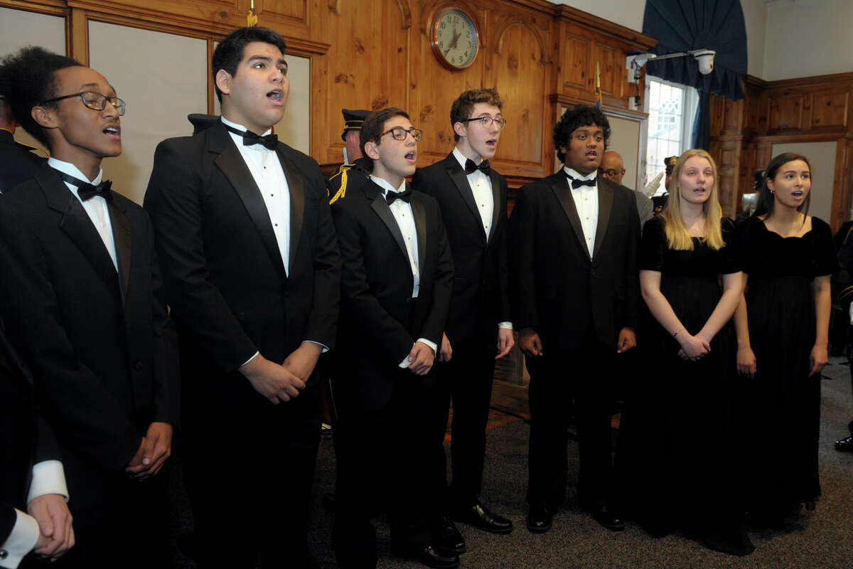 The Brien McMahon High School Choir sings the National Anthem during the swearing in ceremony for Mayor Harry Rilling at Norwalk City Hall, in Norwalk, Conn. Nov. 19, 2019. The sound