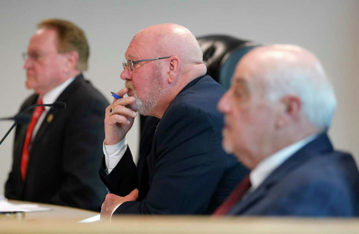 Montgomery County Precinct 2 Commissioner Charlie Riley listens to public comment on a beside Montgomery County Judge Mark Keough, left, and Precinct 1 Commissioner Mike Meador during a Montgomery County Commissioners Court meeting at the Alan B. Sadler Commissioners Court Building, Tuesday, Nov. 19, 2019, in Conroe. Commissioners Court members approved a resolution to make the county a gun sanctuary.