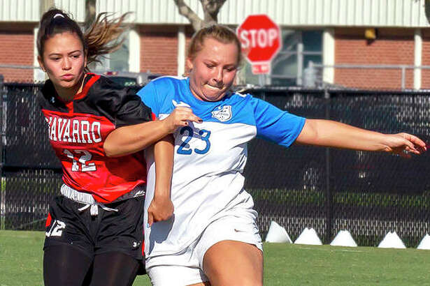 LCCC's Nicci Grellner (23) goes for the ball while arm-in-arm with Navarro's Brianna Garza during Monday's pool game at the NJCAA National Tournament in Melbourne, Fla. LC will face Hill College at 11:30 a.m. CT Wednesday in its last pool game of the tourney.
