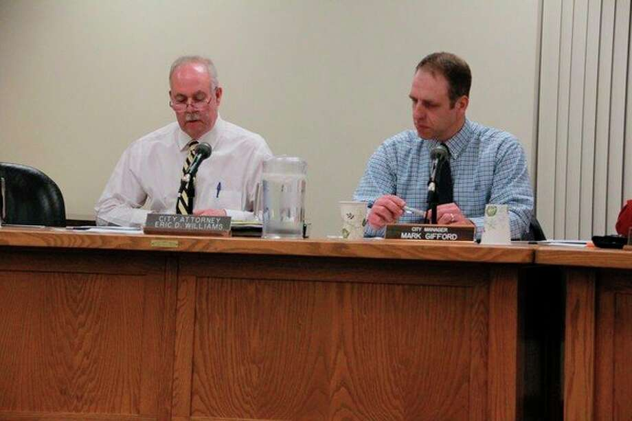 Big Rapids City Attorney Eric Williams (left) informed the Big Rapids City Commission Monday about the errors which invalidated the petition to prohibit recreational marijuana in the city. (Pioneer photo/Alicia Jaimes)