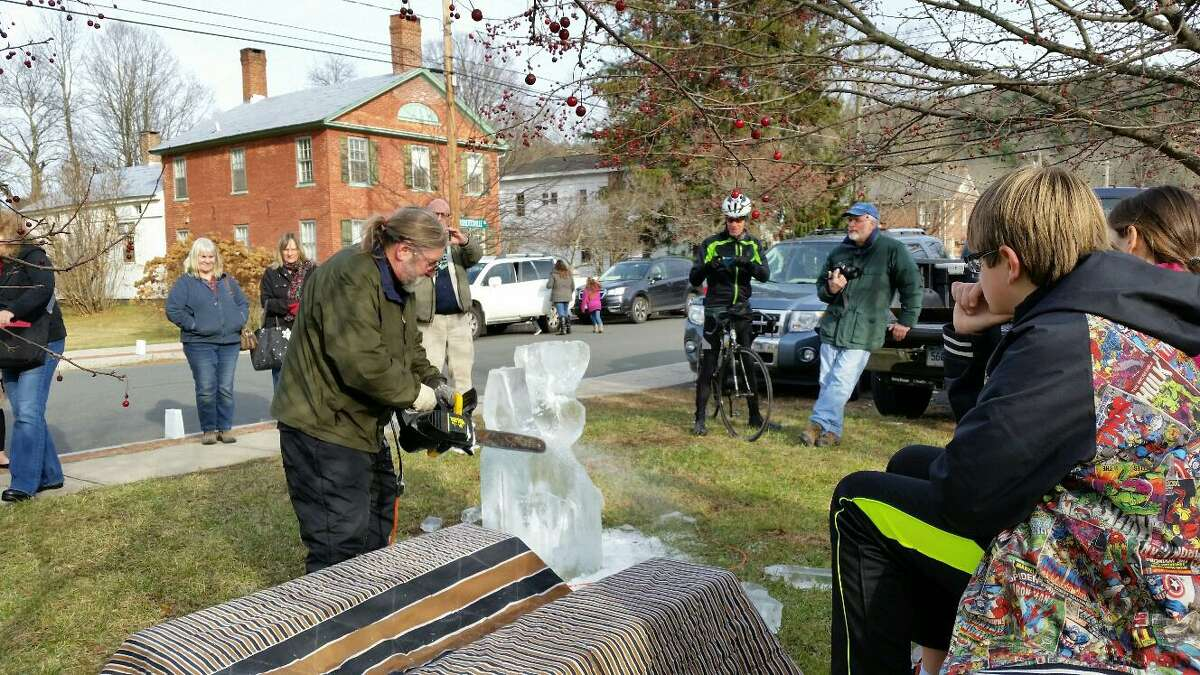 Zejke Hermann of Zejkeart of Cornwall used a die grinder and hand tools to carve a reindeer ice sculpture in the center of town on Saturday afternoon as part of Christmas in Riverton in 2016. This year's event will be held Dec. 6-8, 2019.