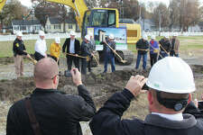 Roxana Mayor Marty Reynolds, right, talks during a ground-breaking ceremony for the new $11 million village hall at the site of the former Burbank Elementary School on Central Avenue. Construction is expected to take about a year. The new building will include village offices, and the Fire and Police departments.