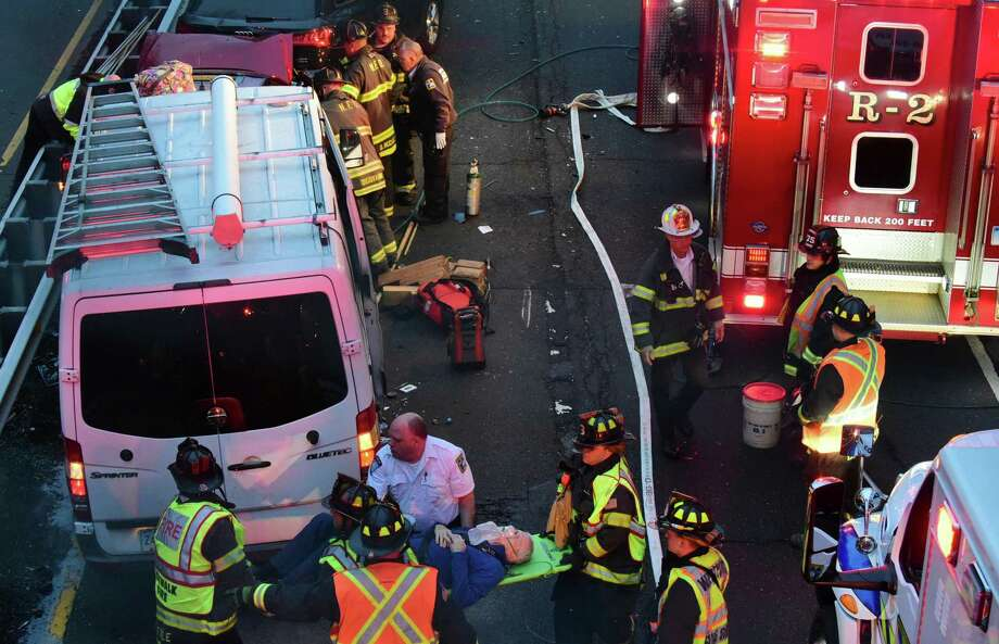 Emergency personnel including Norwalk and Westport Fire Department firefighters respond to the scene of a five car accident on the Merritt Parkway North between exits 40 and 41 Tuesday, November 19, 2019, in Norwalk, Conn. Several persons were extracted from one of the vehicles and sent to Norwalk Hospital for evaluation. Photo: Erik Trautmann / Hearst Connecticut Media / Norwalk Hour