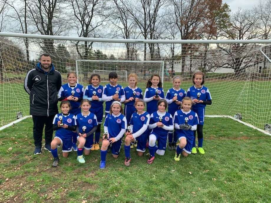 The Norwalk Junior Soccer Association U11 girls captured the B Division title. Photo: Contributed Photo