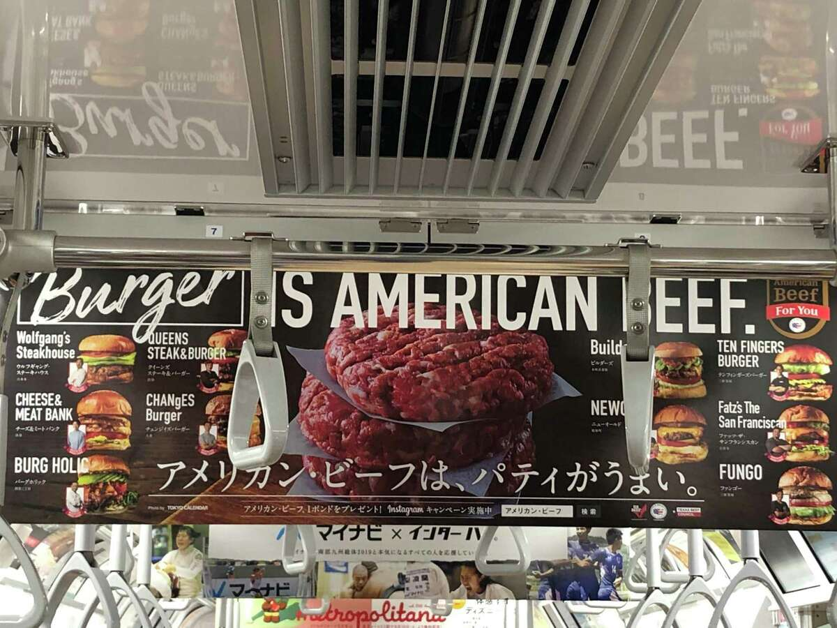 A poster inside a Tokyo subway car promoting American beef. The Beef Promotion and Research Act created a program to help American cattlemen sell more overseas. The livestock industry is now fighting for a law that would it illegal to call anything but a beef patty a burger.
