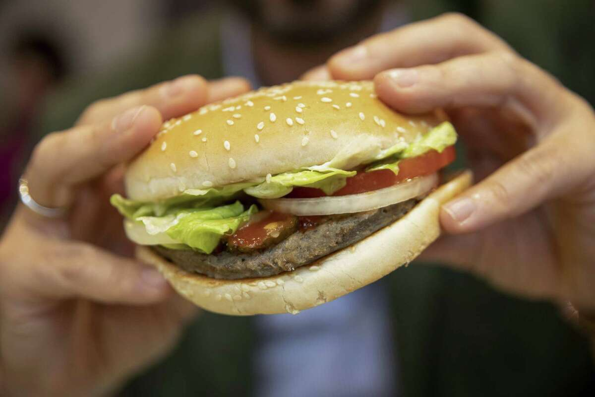 A customer eats a Rebel Whooper at a Burger King Holdings Inc. fast-food restaurant in Milan, Italy, on Tuesday, Nov. 12, 2019. Burger King started offering its meat-free Rebel Whopper across Europe on Tuesday in one of the largest product launches in its history and the first big restaurant deal for Unilever's plant-based patty. Photographer: Camilla Cerea/Bloomberg