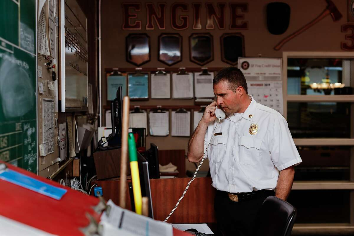 Firefighter Chief Frank Cercos IV takes a call in the communications room at Fire Station No. 38 on Thursday, Nov. 14, 2019, in San Francisco, Calif.