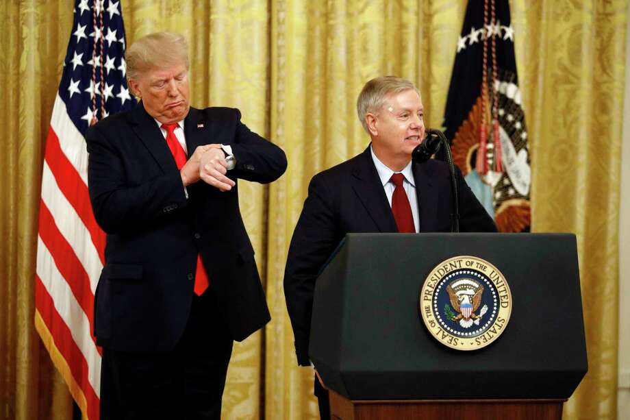 President Donald Trump pretends to check his watch as Sen. Lindsey Graham speaks about an upcoming afternoon vote in the Senate. Graham and the other Republicans have continually criticized the impeachment inquiry — a reader is fed up. Photo: Patrick Semansky /Associated Press / Copyright 2019 The Associated Press. All rights reserved.