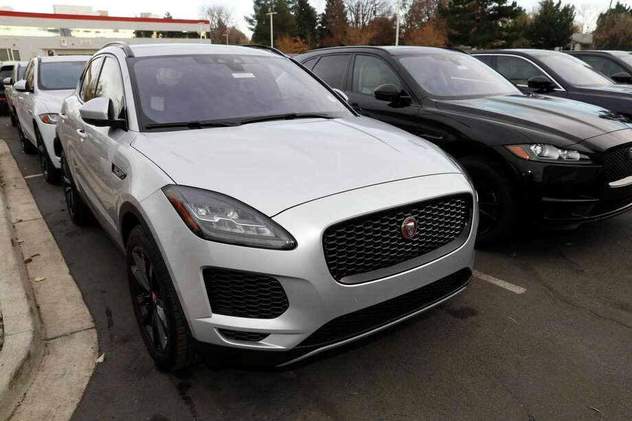 In this Sunday, Nov. 10, 2019, photograph, a long row of unsold E-Pace sports-utility vehicles sits at a Jaguar dealership in Littleton, Colo. (AP Photo/David Zalubowski) Photo: David Zalubowski, STF / Associated Press / Copyright 2019 The Associated Press. All rights reserved.