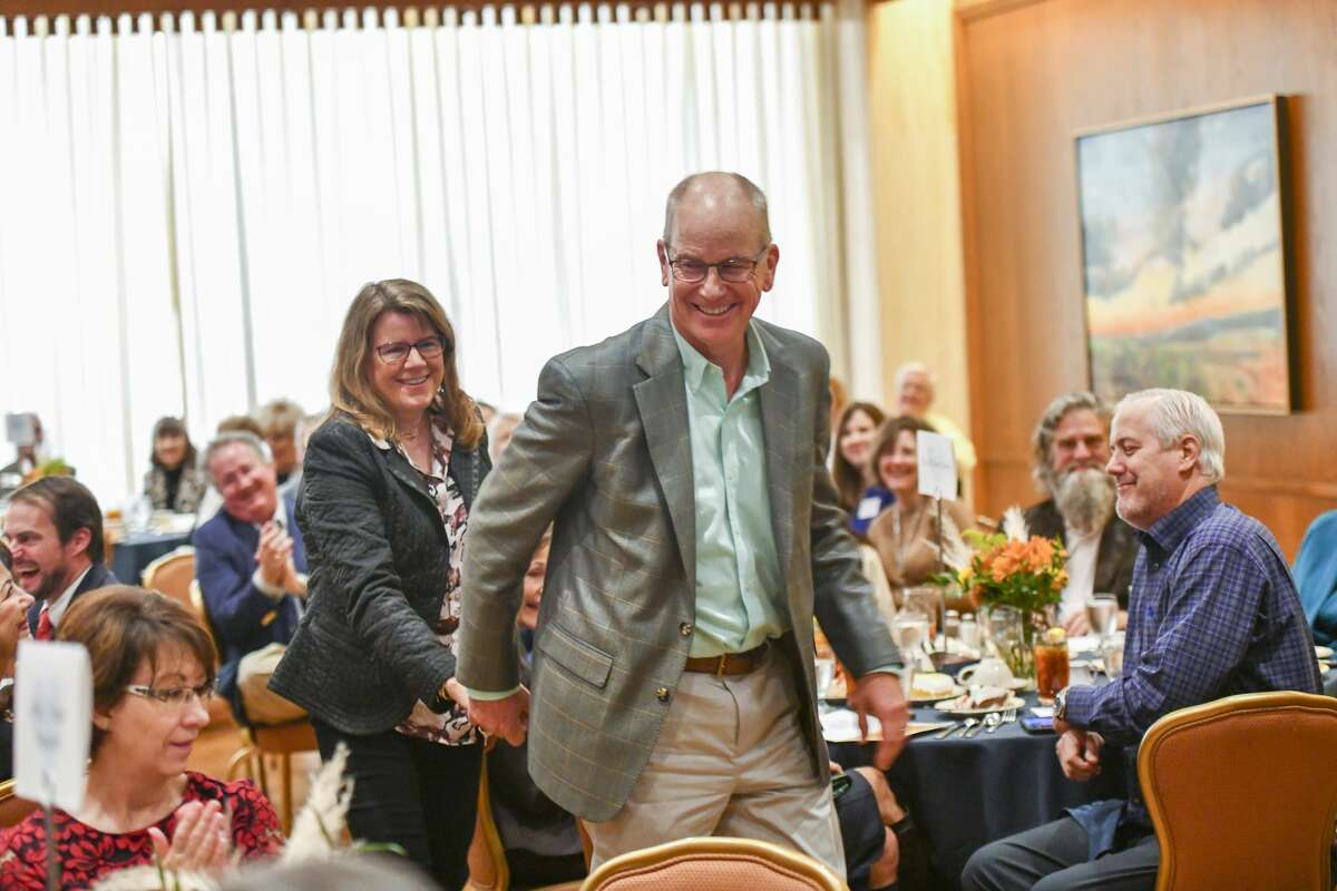 Bill and Mary Anne Dingus walk up to receive Bill?•s award during National Philanthropy Day on Nov. 19, 2019 at the Petroleum Club of Midland. Jacy Lewis/Reporter-Telegram
