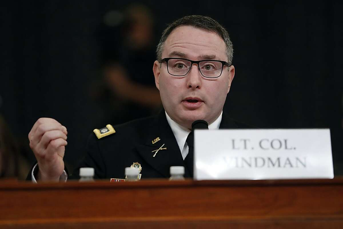 National Security Council aide Lt. Col. Alexander Vindman testifies before the House Intelligence Committee on Capitol Hill in Washington, Tuesday, Nov. 19, 2019, during a public impeachment hearing of President Donald Trump's efforts to tie U.S. aid for Ukraine to investigations of his political opponents. (AP Photo/Andrew Harnik)