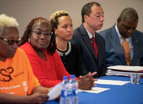 Maxie Hollingsworth (center), a math interventionist at Red Elementary School, listens during a press conference announcing the intention of the Houston Federation of Teachers to join a lawsuit against the Texas Education Agency on behalf of Hollingsworth and two other district teachers, at the HFT's headquarters Houston, Tuesday, Nov. 19, 2019.