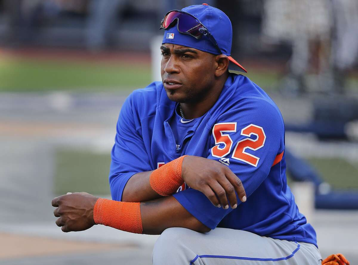 FILE - In this July 20, 2018, file photo, New York Mets' Yoenis Cespedes stretches before the team's baseball game against the New York Yankees in New York. Cespedes is back on the disabled list, and the Mets are still deciding whether the oft-injured slugger needs surgery on both feet that would require an eight-to-10-month recovery. (AP Photo/Julie Jacobson, File)