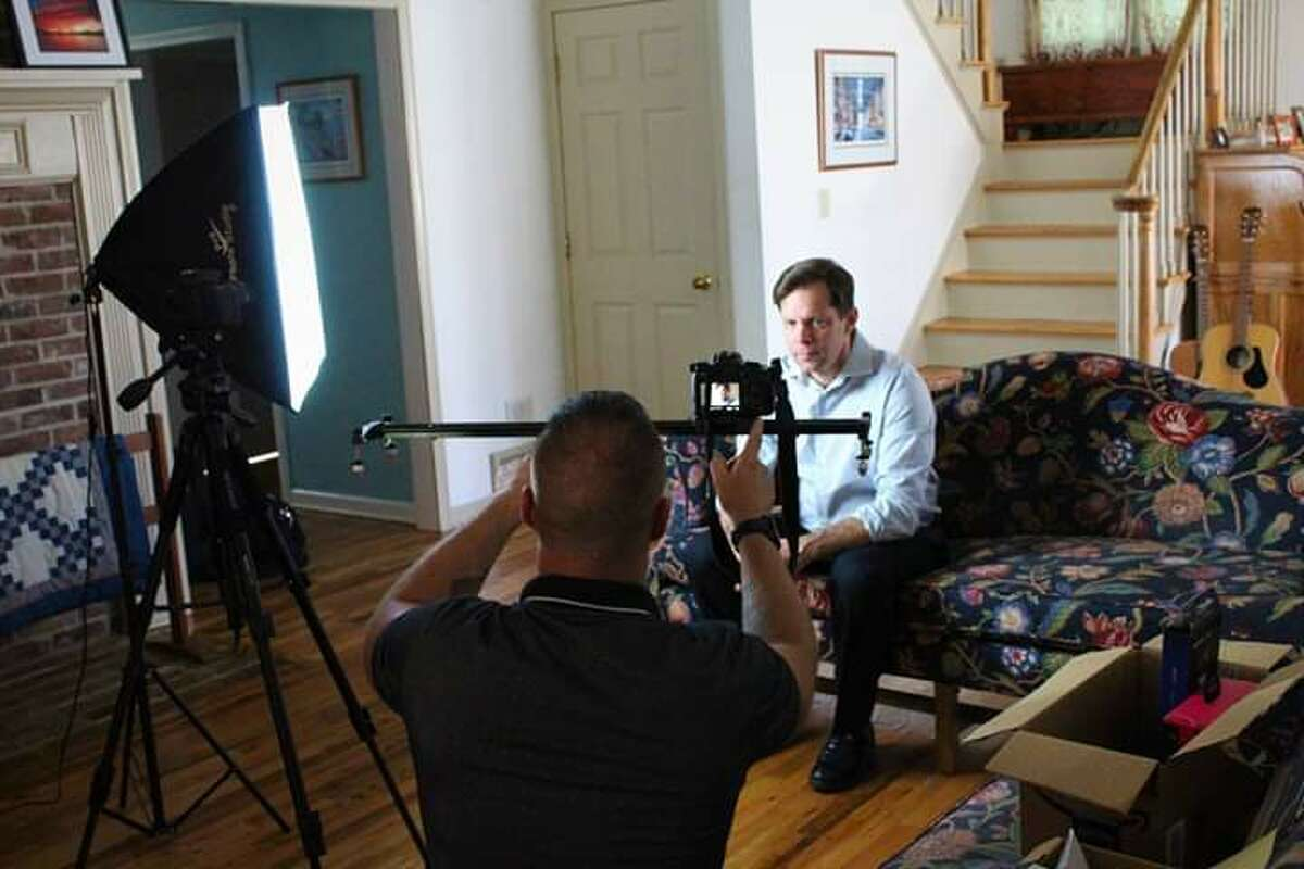 """Co-producer and actor Christopher Gaunt, on couch, shoots a scene from the short film """"Catching Up,"""" which will have its premiere in Glens Falls on Thursday, Nov. 21, 2019."""