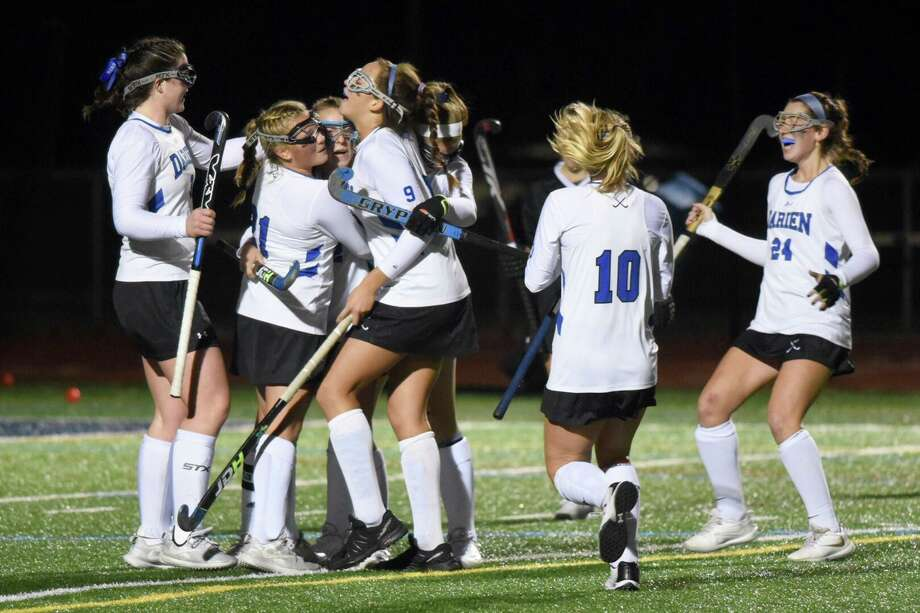 The Darien field hockey team celebrates one of its four goals against Ridgefield in the CIAC Class L field hockey semifinals at Weston High School on Tuesday, Nov. 19, 2019. Photo: David Stewart / Hearst Connecticut Media / Connecticut Post