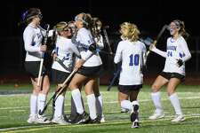 The Darien field hockey team celebrates one of its four goals against Ridgefield in the CIAC Class L field hockey semifinals at Weston High School on Tuesday.