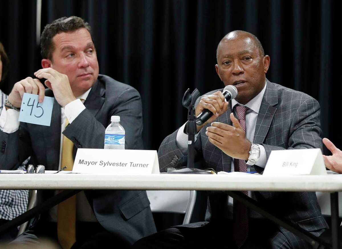 In this Sept. 2, 2019 photo, Mayor Sylvester Turner speaks as Tony Buzbee, left, listens during a mayoral candidate forum. (Karen Warren/Houston Chronicle via AP)