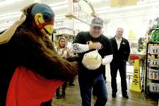 Cumulus Radio's Jammer gets ready for his second attempt during the 2nd annual Celebrity Turkey Bowl Tuesday at the Market Basket on Phelan Road in Beaumont. Teams from various local media joined in the event, each bowling with turkeys to raise money for local charitable organizations. Photo taken Tuesday, November 19, 2019 Kim Brent/The Enterprise