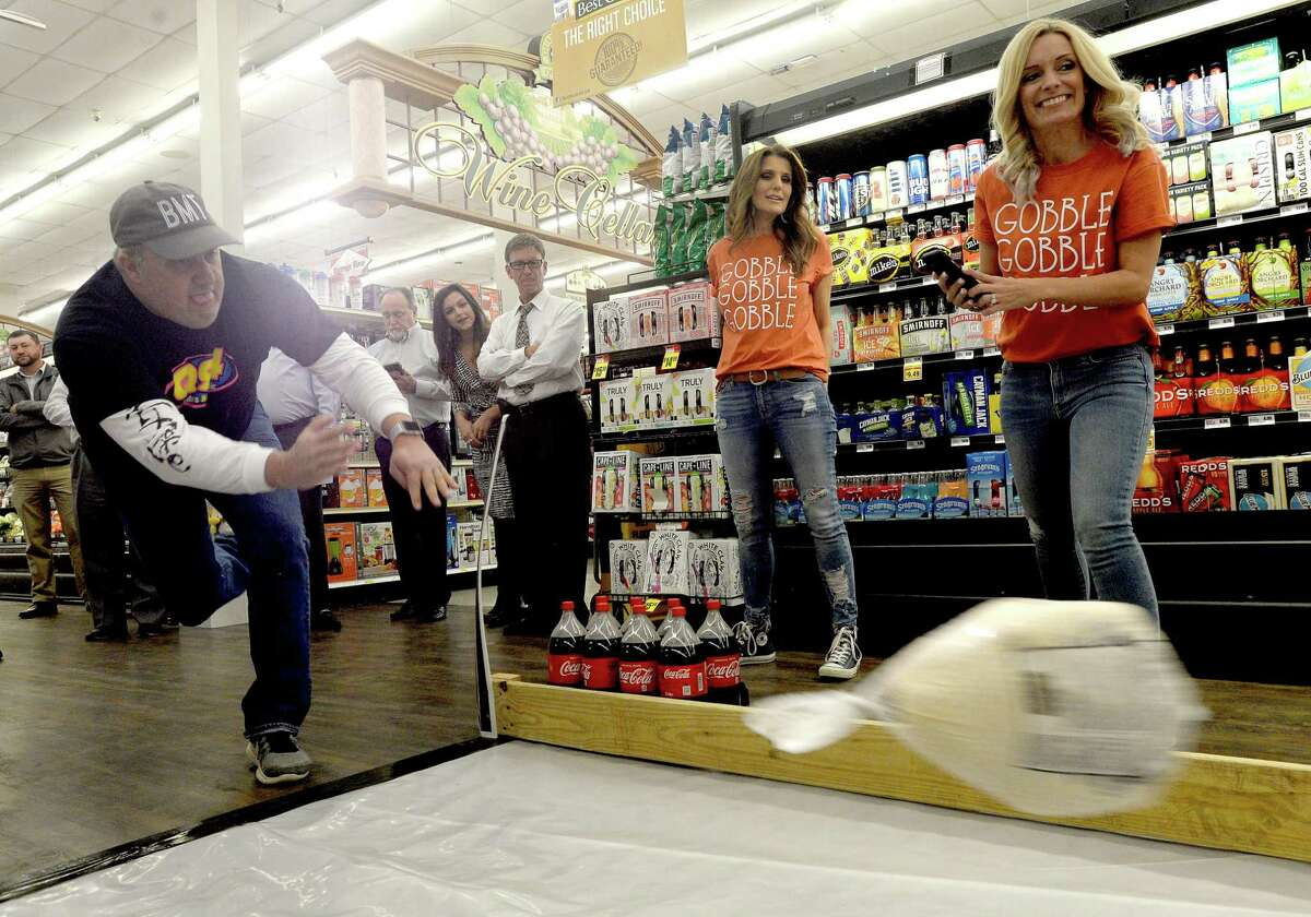 Jammer sends another frozen turkey flying down the lane during the 2nd annual Celebrity Turkey Bowl Tuesday at the Market Basket on Phelan Road in Beaumont. Teams from various local media joined in the event, each bowling with turkeys to raise money for local charitable organizations. Photo taken Tuesday, November 19, 2019 Kim Brent/The Enterprise