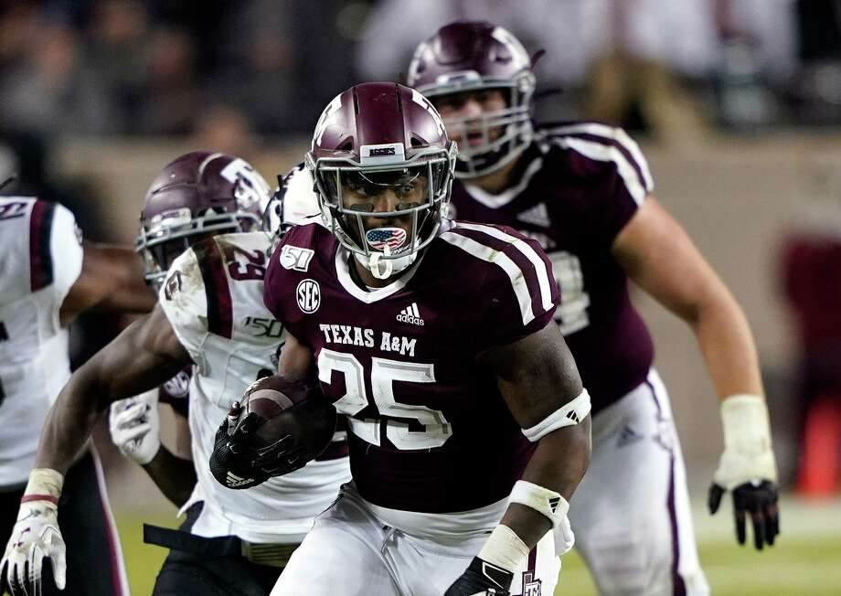 Running back Cordarrian Richardson was part of a Texas A&M offense that held the ball for 41 minutes and 39 seconds in last week's 30-6 victory over South Carolina at College Station. Photo: David J. Phillip, STF / Associated Press / Copyright 2019 The Associated Press. All rights reserved.