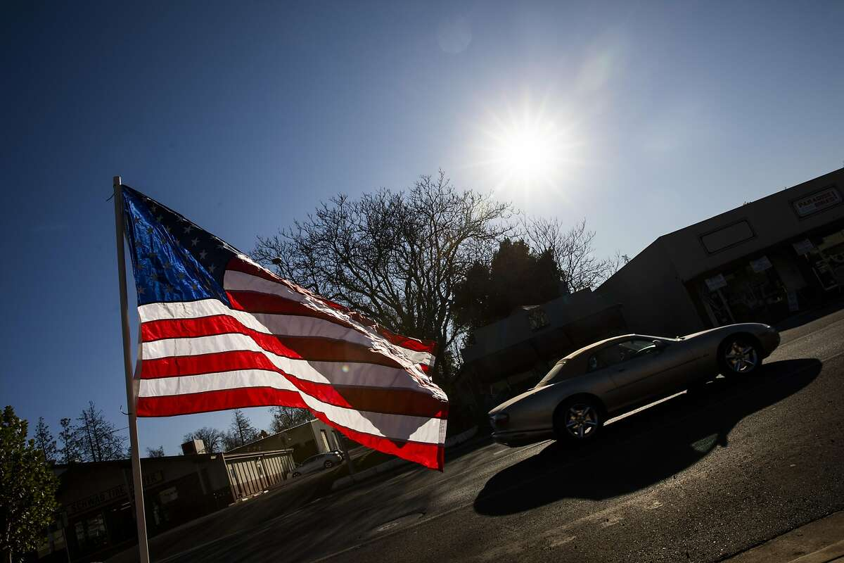 PARADISE, CA - NOVEMBER 08: American flags fly along Skyway Road during the one year anniversary of the Camp Fire on November 8, 2019 in Paradise, California. It has been one year since the Camp Fire, caused by PG&E transmission lines, tore through the town of Paradise, California, killing 85 people and destroying more than 18,000 homes and businesses, becoming the deadliest and most destructive fire in the history of California. (Photo by Philip Pacheco/Getty Images)