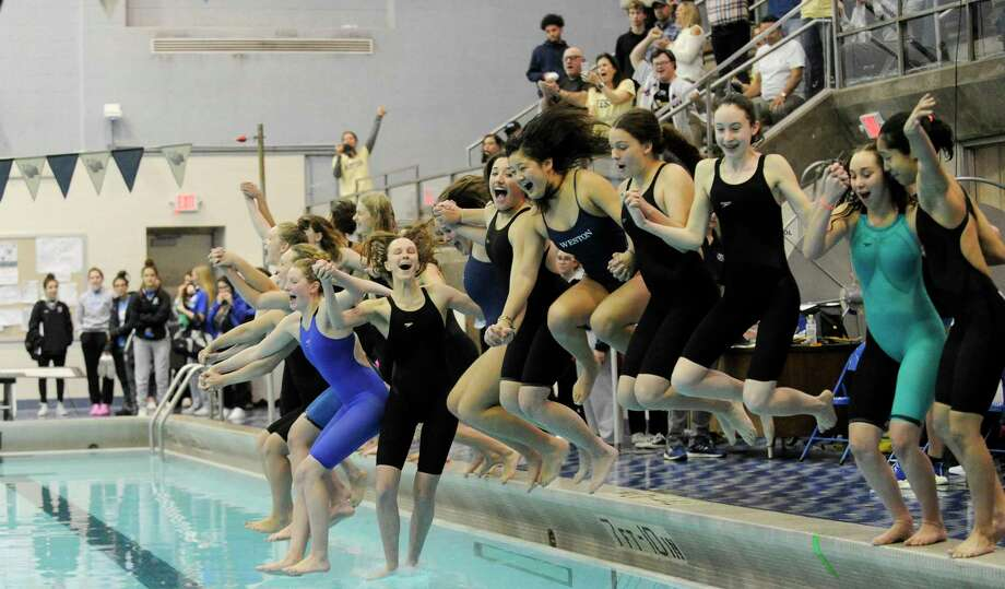 Weston celebrates after winning the Class S swimming state championships with a team toal of 893.5 at the Hutchinson Natatorium at Southern Connecticut State Unversity in New Haven, Conn. on Nov. 19, 2019. Photo: Matthew Brown, Hearst Connecticut Media / Stamford Advocate