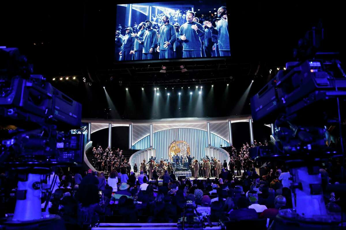 """Rapper Kayne West performs with a choir some of the songs from his """"Jesus is King"""" album during a Sunday Service Experience at Lakewood Church on Sunday, Nov. 17, 2019 in Houston."""