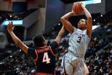 Connecticut's Megan Walker (3) shoots over Virginia's Dominique Toussaint during the first half of an NCAA college basketball game,Tuesday, Nov. 19, 2019, in Hartford, Conn. (AP Photo/Jessica Hill)