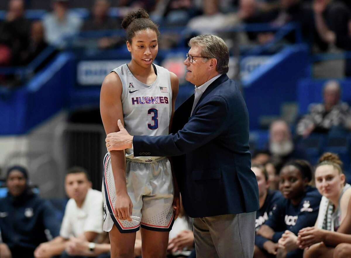 Connecticut head coach Geno Auriemma, right, talks with Connecticut's Megan Walker during the first half of an NCAA college basketball game, Tuesday, Nov. 19, 2019, in Hartford, Conn. (AP Photo/Jessica Hill)