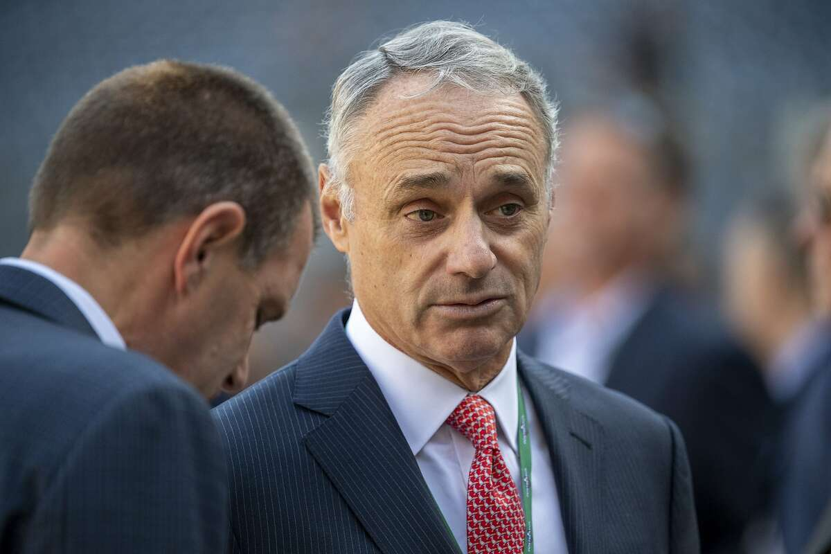 FILE -- Major League Baseball Commissioner Rob Manfred attends batting practice before game three of the American League Championship Series at Yankee Stadium in New York, Oct. 15, 2019. As the MLB continues its investigation into allegations of electronic sign stealing by the Houston Astros, Manfred said on Nov. 19 that he had the power to enact significant penalties, suggesting that the league was taking the issue much more seriously than it had in the past. (Ben Solomon/The New York Times)