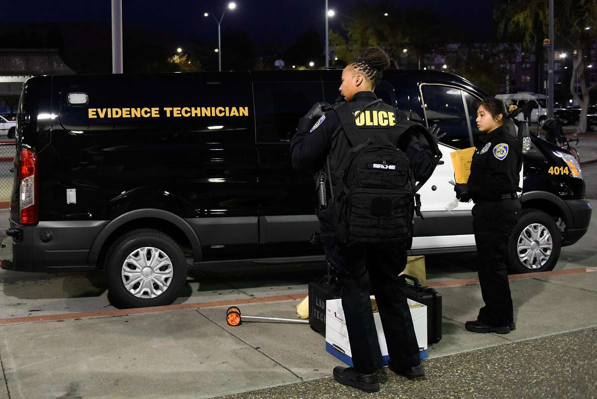 BART Police pack evidence into their van outside of the South Hayward BART Station after a homicide on one of the transit system's trains on November 20, 2019 in Hayward, Calif.