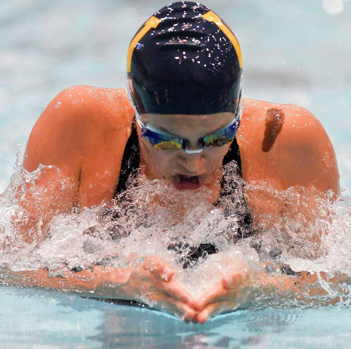 Weston's Isabella Gary competes in the Girls 200 yard medley relay in the Class S swimming state championships at the Hutchinson Natatorium at Southern Connecticut State Unversity in New Haven, Conn. on Nov. 19, 2019.