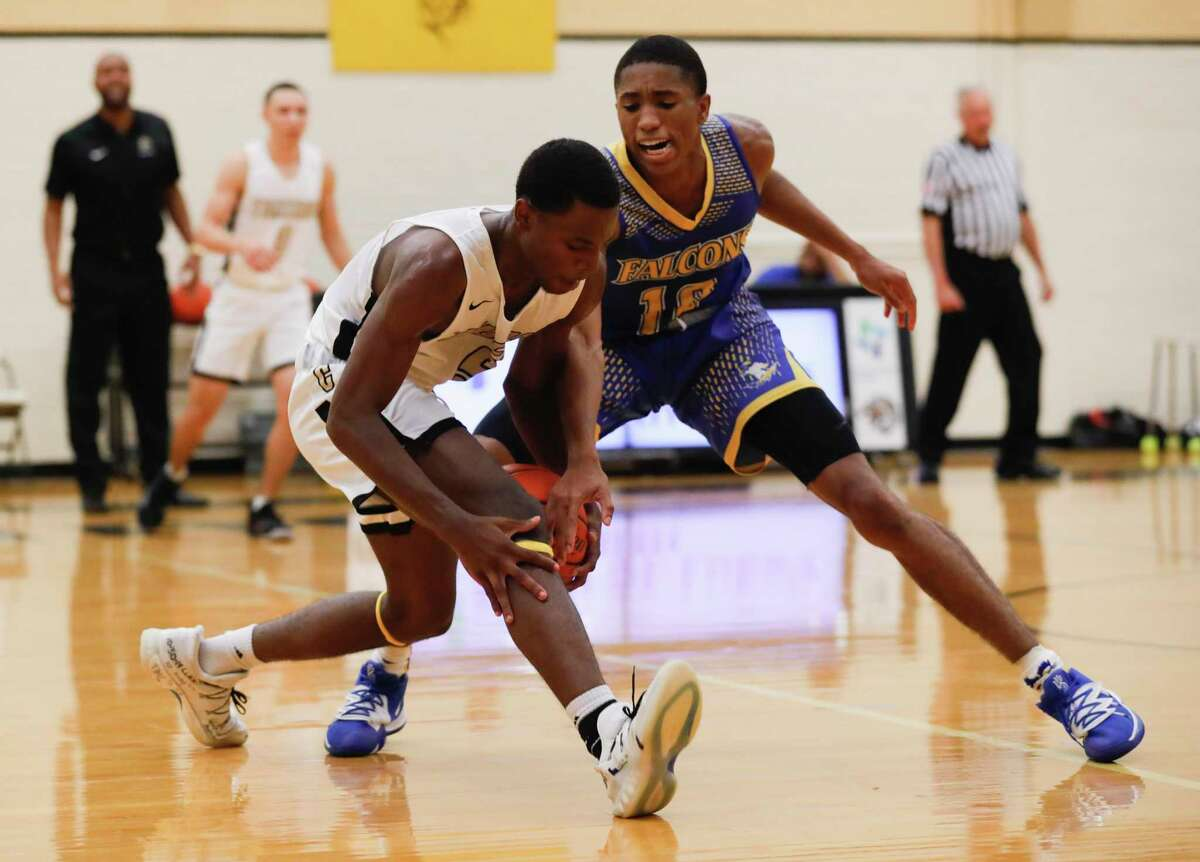 Conroe KJ Micheaux (5) gets tangled up by Channelview small forward Jerome Chachere II (10) as he forces a turnover by Micheaux during the second quarter of a non-district high school basketball game at Conroe High School, Tuesday, Nov. 19, 2019, in Conroe.