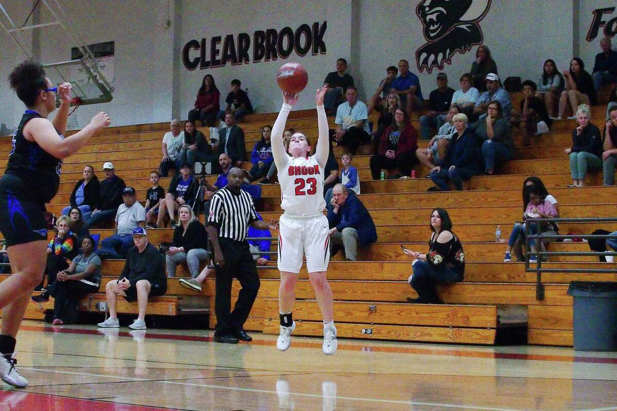 Clear Brook's Madison Caffey (23) launches a shot against Friendswood Tuesday at Clear Brook High School.