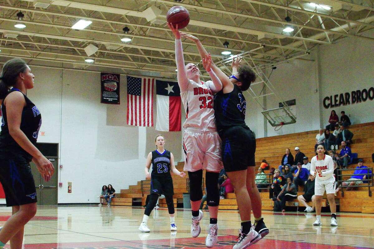 Clear Brook's Veyda Lake (32) tries to put up a shot over Friendswood's Ashlyn Mason Tuesday at Clear Brook High School.