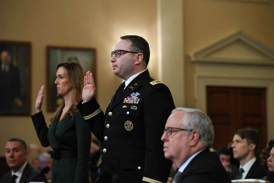 Lieutenant Colonel Alexander Vindman and Jennifer Williams are sworn in before the House Intelligence Committee on Nov. 19, 2019. Photo: Washington Post Photo By Matt McClain / The Washington Post