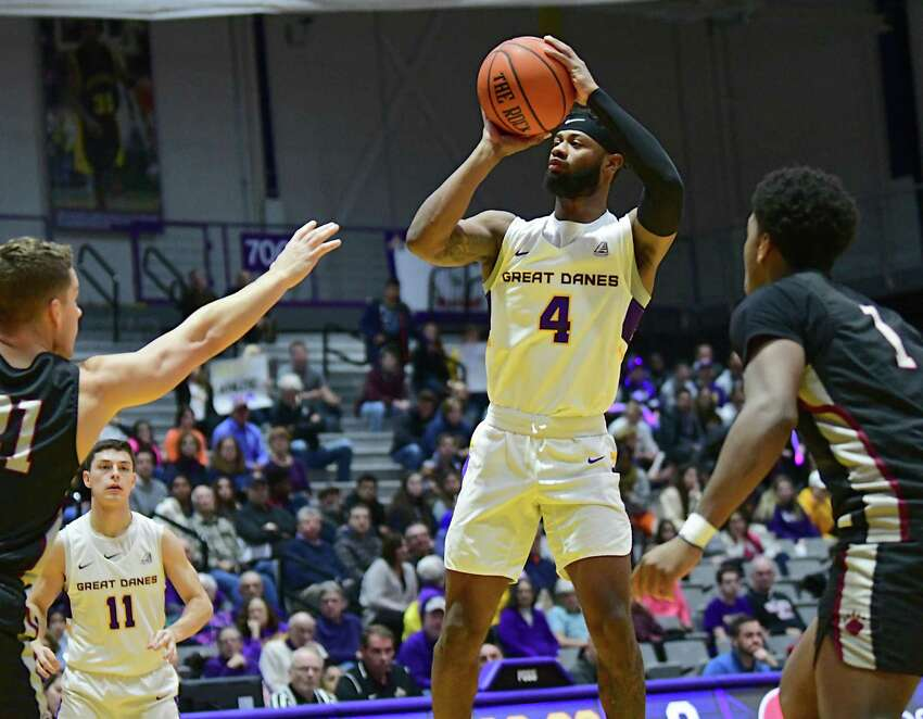 University at Albany's Ahmad Clark sinks a three-pointer during a basketball game against Potsdam at SEFCU Arena on Tuesday, Nov. 19, 2019 in Albany, N.Y. (Lori Van Buren/Times Union)
