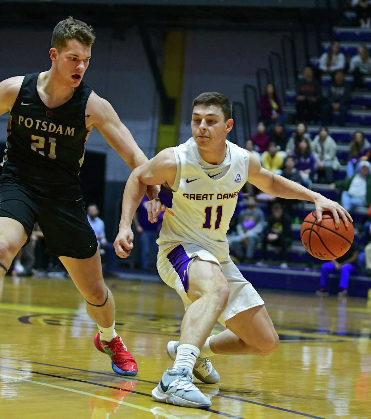 University at Albany's Cameron Healy is guarded by Potsdam's Aaron Armstrong during a basketball game at SEFCU Arena on Tuesday, Nov. 19, 2019 in Albany, N.Y. (Lori Van Buren/Times Union)
