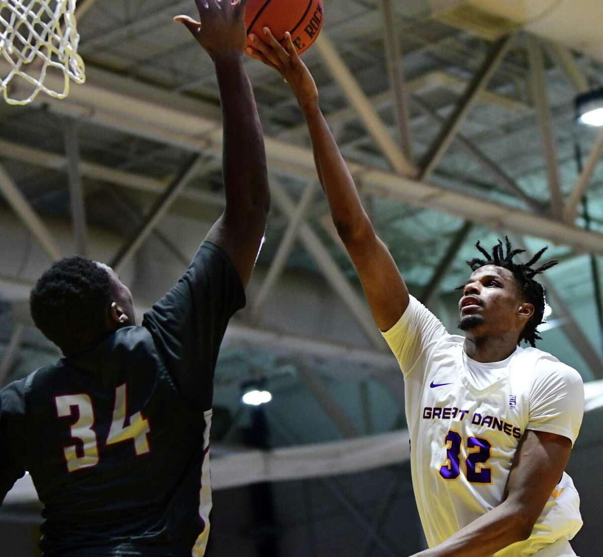 University at Albany's Romani Hansen drives to the hoop against Potsdam's Tyrese Baptiste during a basketball game at SEFCU Arena on Tuesday, Nov. 19, 2019 in Albany, N.Y. (Lori Van Buren/Times Union)